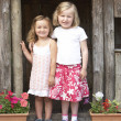 Two Young Girls Playing in Wooden House - Stockfoto