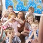 Montessori/Pre-School Class Listening to Teacher on Carpet — Stock Photo