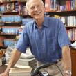 Male bookshop proprietor — Stock Photo