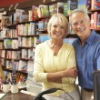 Couple running bookshop — Stock Photo #4815496
