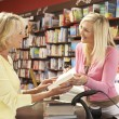 Stock Photo: Female customer in bookshop