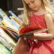 Young girl in bookshop — Stock Photo