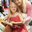 Mother and daughter in bookshop — Stock Photo