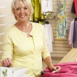 Female sales assistant in clothing store — Stock Photo #4815526