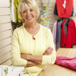 Female sales assistant in clothing store — Stock Photo #4815527