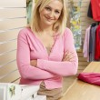 Female sales assistant in clothing store — Foto Stock