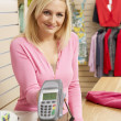 Female sales assistant in clothing store — Stock Photo #4815532