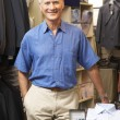 Male sales assistant in clothing store - Stock Photo