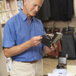 Male customer in clothing store — Stock Photo