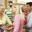 Female sales assistant in health food store — Foto de Stock