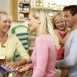 Female sales assistant in health food store — Stock Photo #4815565
