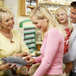 Female sales assistant in health food store — Stock Photo #4815566