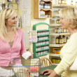 Female sales assistant in health food store — Stock Photo #4815573