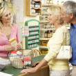 Female sales assistant in health food store — Stock Photo