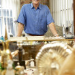 Male antique shop proprietor — Stock Photo
