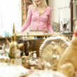Foto Stock: Female antique shop proprietor