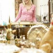 Foto de Stock  : Female antique shop proprietor