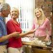 Foto Stock: Couple shopping in antique shop