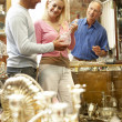 Stock Photo: Couple shopping in antique shop