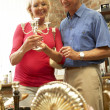 Middle aged couple shopping for antiques — Stock Photo