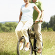 Mature couple riding bike in countryside — Stock Photo #4815602