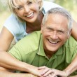 Mature couple having fun in countryside — Stock Photo #4815626