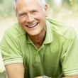 Portrait of mature man relaxing in countryside — Stock Photo