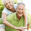 Stock Photo: Mature couple having fun in countryside