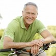 Portrait of man riding cycle in countryside — Stock Photo #4815657