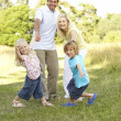 Family having fun in countryside — Stock Photo