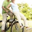 Mature couple riding bike in countryside — Stock Photo #4815677