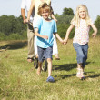 Family having fun in countryside — Stock Photo #4815680