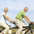 Mature couple riding tandem — Stock Photo #4815684