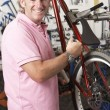 Owner of cycle shop in workshop — Stock Photo #4815694