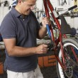 Owner of cycle shop in workshop — Stock Photo #4815696