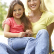 Portrait Of Mother And Daughter In Park — Stockfoto