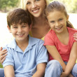 Stock Photo: Mother With Children In Park