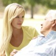 Senior Man Talking To Concerned Adult Daughter — Stock Photo #4815779