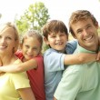Mother And Father Giving Children Piggy Back — Stock Photo