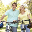 Young Couple On Cycle Ride in Park — Stock Photo #4815793