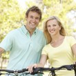 Young Couple On Cycle Ride in Park — Stock Photo
