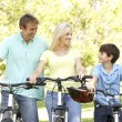 Parents And Son On Cycle Ride In Park — Stock Photo