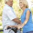 Senior Couple On Cycle Ride In Park — Stock Photo #4815805