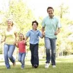 Family Running In Park — Stock Photo