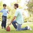 Father And Son Playing American Football Together — Stock Photo #4815817