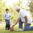 Grandfather And Grandson Playing American Football Together — Stock Photo #4815819