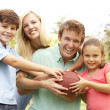 Family Playing American Football Together In Park — Stock Photo #4815825