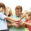 Stock Photo: Family Playing American Football Together In Park