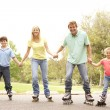 Family Wearing In Line Skates In Park — Stock Photo
