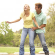 Couple Wearing In Line Skates In Park — Stock Photo